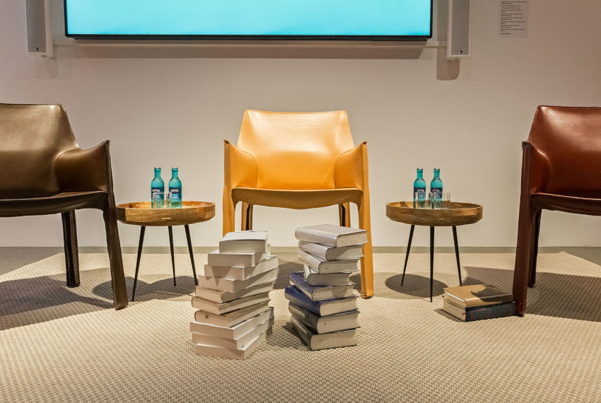 Three chairs and a pile of books